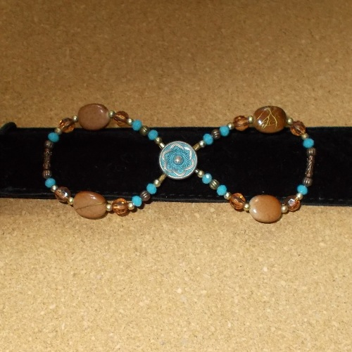 Antique Torquoise Infinity barrette made and supplied by Longhaired Jewels