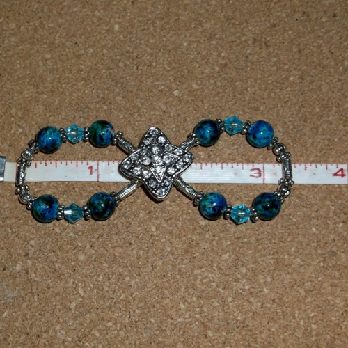 Sea Breeze infinity barrette supplied by Longhaired Jewels
