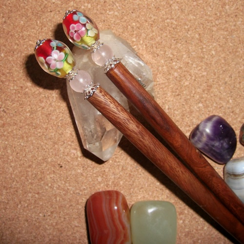 Teak hairsticks topped with lovely floral style beads handmade by Longhaired Jewels